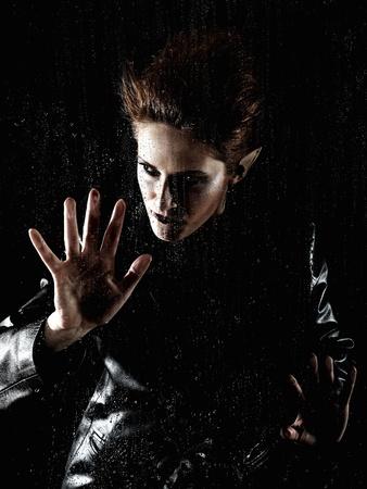 demoniacal: Portrait horrible fashion vampire woman behind rainy window