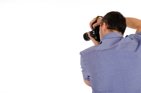 professional male photographer from back taking picture.copyspace . isolated on white background  Stock Photo