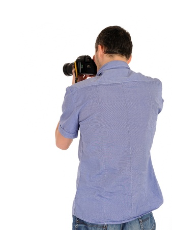 professional male photographer from back taking picture.copyspace . isolated on white background  Standard-Bild