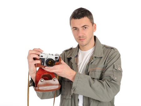 Young professional photographer with old retro film camera. isolated on white background Stock Photo - 8871841