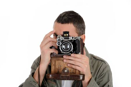 Young professional photographer with old retro film camera. isolated on white background photo