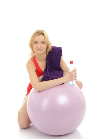 Pretty fitness woman doing exercise with pilates ball. isolated on white background photo