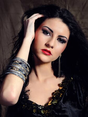 Beautiful model woman with long black healthy hair in arabic traditional clothes photo