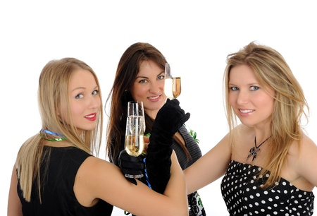 three beautiful woman with glasses of champagne celebrating on party. isolated on white background photo