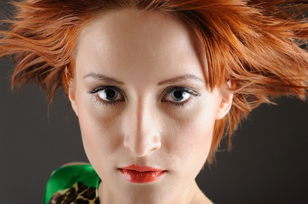 Beauty portrait of pretty woman with healthy red flying hair, pure skin and natural make-up. copy-space Stock Photo