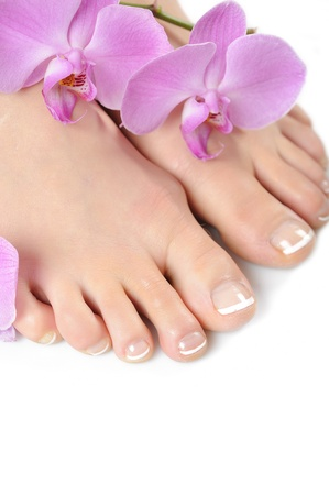 french pedicure: Beautiful feet with perfect spa french nail pedicure.isolated