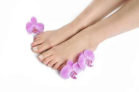 Beautiful feet with perfect spa french nail pedicure.isolated Stock Photo - 8949666