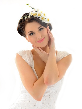 Beautiful spring woman with pure skin and flowers in her hair Stock Photo