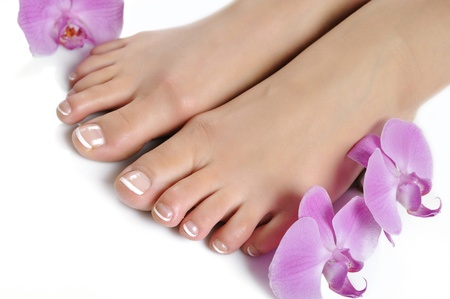 Beautiful feet with perfect spa french nail pedicure.isolated photo