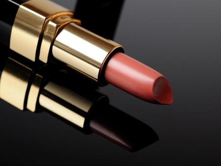 Luxury pink lipstick on black background. make-up photo