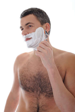 Young handsome male  shaving face beard . isolated on white background photo