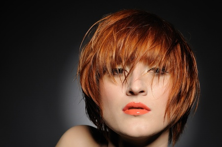 Beautiful red heaired woman portrait with fashion hairstyle from salon Stock Photo
