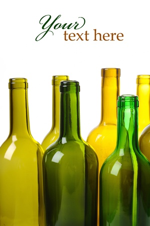 Many empty green wine bottles isolated on white background photo