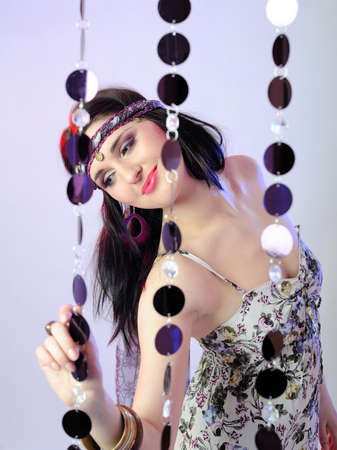 Pretty sexy fashion woman in hippy style smiling photo