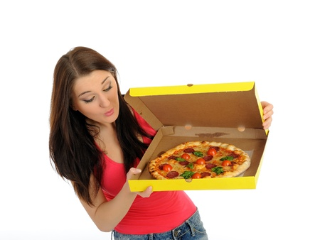 Pretty young casual girl with tasty pizza in delivery paper box. isolated on white background photo