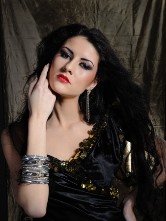 Beautiful model woman with long black healthy hair and bright make-up photo