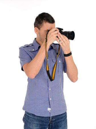 professional male photographer taking picture . isolated on white background  photo