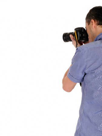 back to camera:  professional male photographer from back taking picture.copyspace . isolated on white background  Stock Photo