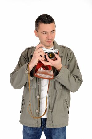 Young professional photographer with old retro film camera. isolated on white background Stock Photo - 9160607