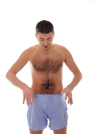 pene: Giovane uomo bello alla ricerca nei pantaloni