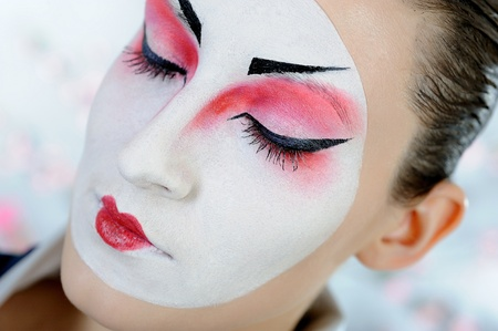 close-up artistic portrait of japan geisha woman with creative make-up  photo