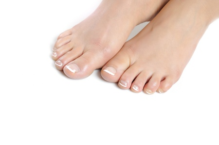 Beautiful feet leg with perfect french spa pedicure. white background Standard-Bild
