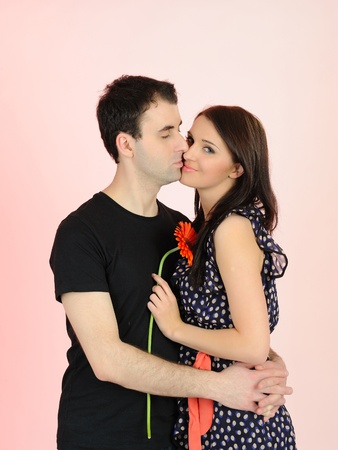 lovely romantic couple with flower embracing Stock Photo - 9277031