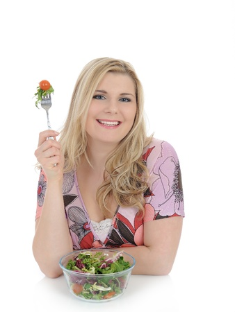 beautiful woman eating green vegetable salad. isolated on white  Standard-Bild