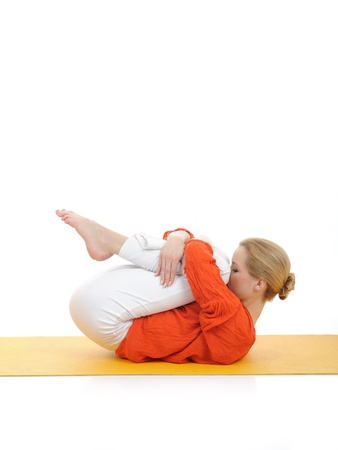 series or yoga photos. young woman doing relaxing exercise on yellow pilates mat Stock Photo - 9313668