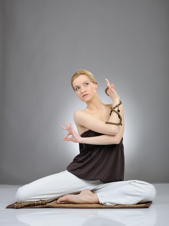 Creative portrait of young woman in yoga relaxation pose photo