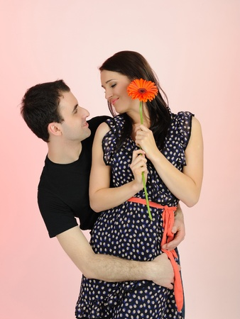 lovely romantic man giving flower to a woman photo