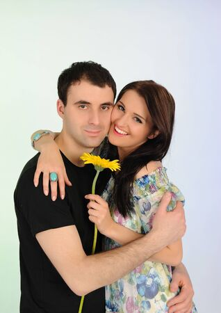 lovely romantic couple with flower embracing photo