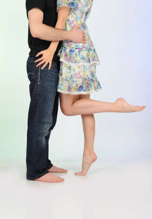 Legs of beautiful couple kissing. studio shot photo