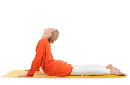 series or yoga photos. young woman in cobra pose on yellow pilates mat Standard-Bild