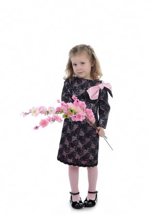Pretty little girl in black elegant party dress with flowers. isolated Stock Photo - 9392409