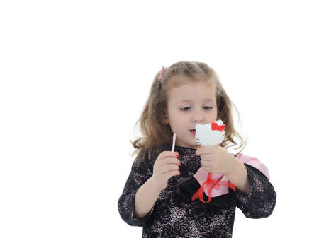 Pretty little girl with child lipstick. isolated Stock Photo - 9392414