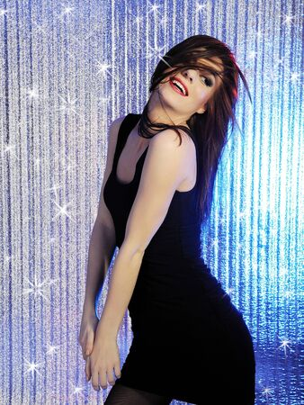 Attractive sexy woman clubbing, dancing in the disco and moving her hair Stock Photo - 9484483