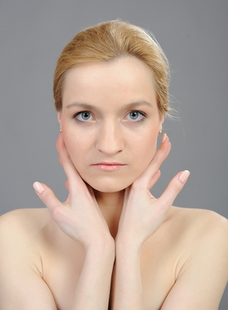 Pretty womans face with pure healthy skin Stock Photo - 9484421