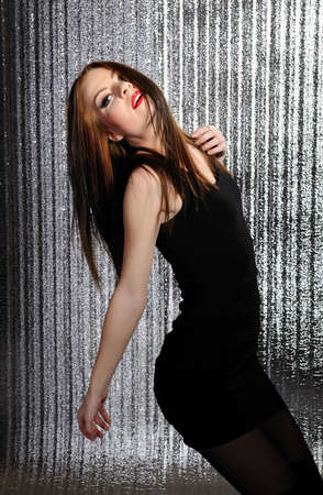 Attractive sexy woman clubbing, dancing in the disco and moving her hair photo