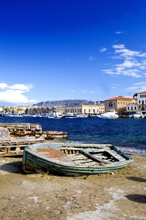 Rusty old boat on the shore in Greece island Crete photo
