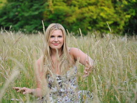 Pretty summer woman on yellow wheat field in countryside Stock Photo - 9678354