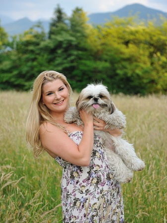 Beautiful female with cute little dog friend outdoors photo