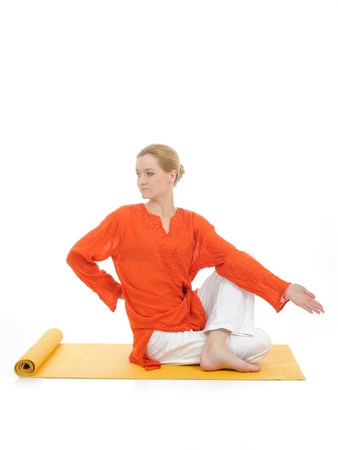 series or yoga photos. young woman doing yoga pose on yellow pilates mat photo