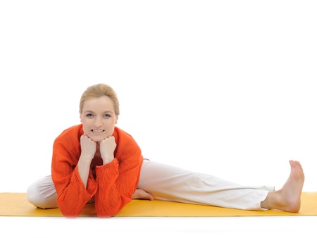 series or yoga photos. young woman doing yoga stretching pose on yellow pilates mat photo