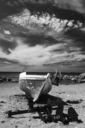 grundge: Rusty old boat on the shore in Greece island Crete