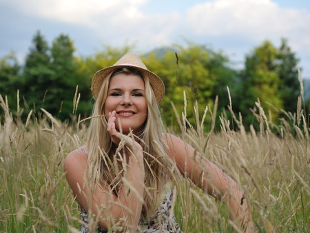Pretty summer woman on yellow wheat field in countryside Stock Photo - 9802266