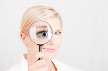 market research: woman with zooming lence searching Stock Photo