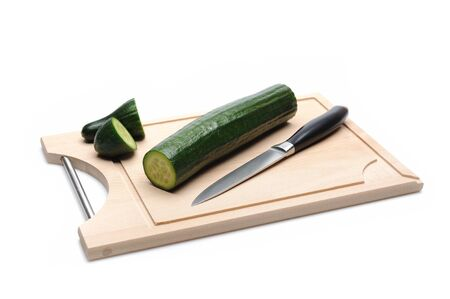 green cucumber on wooden board isolated. sushi ingredients Stock Photo - 11079814