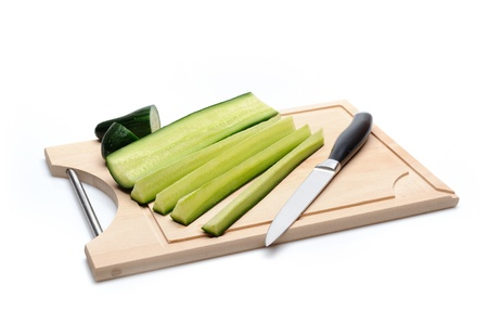 green cucumber on wooden board isolated. sushi ingredients Stock Photo - 11079818