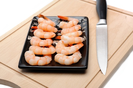 fresh shrimps on wooden board isolated. sushi ingredient Stock Photo - 11079842
